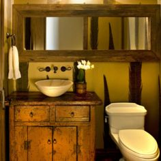 A rustic and earthy bathroom in a Tuscan designed home