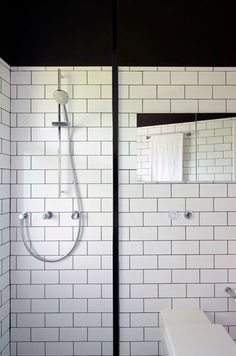 White subway tile with black grout: classic in the truest sense.