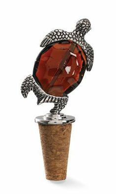 Mud Pie Turtle Bottle Topper by Mud Pie company. $16.60. This bottle stopper measures 5-inch tall. Perfect hostess gift - pair with their favorite bottle of wine. Fits any standard wine bottle. Coordinates with other Mud Pie accessories. Hand washing is recommended. Top off your bottle with style this cast metal bottle topper features an amber glass beaded turtle design and arrives in acetate tube box with decorative bow and matching to/from gift tag.
