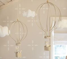hot air balloon hanging decor from Pottery Barn Kids. Could this be DIY'ed? cause it's stinkin' adorable!
