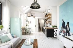 Kitchen and sititng room open plan living space in a charming one room Swedish apartment