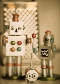 These robots would be fun for kids to make!... Woodsies, glue, paint, & Modge Podge.