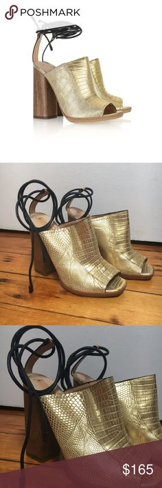 """Reed Krakoff gold lizard heels w/ ankle ties, 37.5 Reed Krakoff gold lizard mules with wood heel and black waxed cotton ankle ties. Comes with dustbag.  Size: 37.5 Condition: good, lightly worn, minor scuffs and discoloration as pictured Measurements: 0.5"""" platform, 4.75"""" heel Reed Krakoff Shoes Heels"""