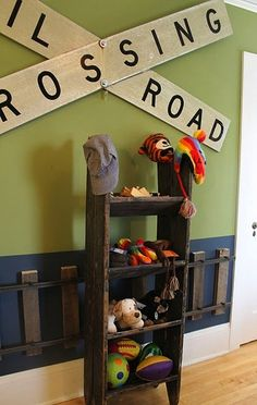Trendy Woodwork on Kids' Room Walls | KidSpace Interiors---my Peanut would be beside himself if he had tracks on the wall.