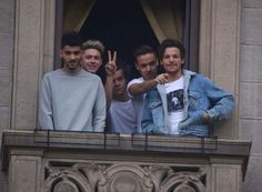 The boys on their balcony waving to fans in Milan!