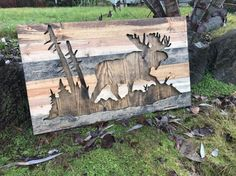This is a completely one of a kind piece. There is no other like it out there. The moose silhouette in the nature gives it a very outdoorsy, rustic element. This piece is made out of pine uniquely stained to look like rustic reclaimed wood. It measures 36x22 and is preinstalled with a wire for hanging. **NOTE - This piece is made to order. The picture displayed is the template and will be the same design but may have different wood grains since no two pieces of wood are ever the same. This…
