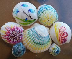 Drawing on shells... a new canvas! I especially like the ones with holes in them.