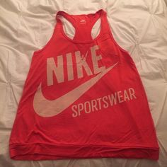 Nike Active racerback tank sz S orange Awesome vintage looking Nike racerback tank. Super soft jersey/stretchy fabric. Hangs loosely on the body. Size small but meant to fit oversized. Perfect condition! Nike Tops Tank Tops