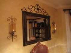 Living Room Decor Inspiration for above foyer table....still need another sconce and decor above the mirror