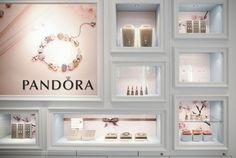 With a personality and DNA so uniquely different from other jewellery brands, Pandora called for an equally unique store design, freeing the myriad of charms from glass counters, allowing clients to interact and try each charm on their wrists. Jewelry Store Displays, Jewellery Shop Design, Jewellery Showroom, Clothing Store Interior, Grey Interior Design, Counter Design, Showroom Design, Trend Fashion, Shop Interiors