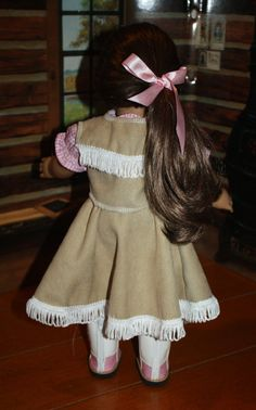 This is a pink and brown version of the cowgirl outfit. It is already made, but I only have one like this with a pink hat and boots. (If you would like a set similar to the red one in the other listing, it will come with a brown hat and brown and white or pink and white boots. Send me a convo for a custom outfit.) Outfit consists of:  One piece peasant style cowgirl shirt with attached faux suede skirt, trimmed with white fringe - sleeves and waist are elasticized. Faux suede belt closes in…