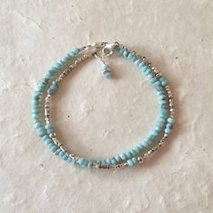Larimar, Karen Hill Tribe Thai silver beaded bracelet with dangle Bracelet measures 7 inches, or custom size ♥♥♥♥♥♥♥♥ Larimar metaphysical properties: Clarity of communication, relieves stress, dissolves emotional barriers, releases negative emotions, peace, relaxation