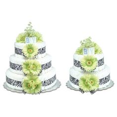 Each tier of the baby diaper cake is tied with zebra print grosgrain ribbon and decorated with vibrant lime green daisies. Bloomers Baby Diaper Cakes come wrapped in white tulle, tied with a satin bow and secured with an old-fashioned diaper pin.Small:  $74.95  Large:  $118.95Manufactured by Bloomer's Baby, these diaper cakes are world class, as seen on the Today Show, The View, and Enterainment tonight.  The Small diaper cakes measures 12x12x12 and contains around 40 diapers.The Large cake…