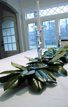Magnolia leaves centerpiece ...simply staple to piece of scrap wood ...glue gun top pieces for dimension...