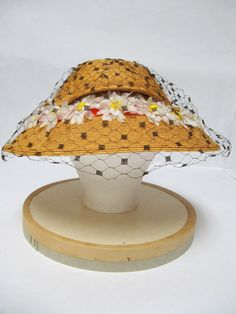 1950's Leslie James Straw Hat with Brown Netting and Daisies. $150.00, via Etsy.