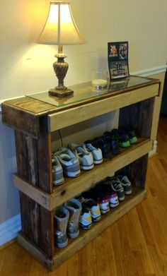 Rustic reclaimed pallet furniture shoe shelf book case storage unit- this would be great by the front door for all the shoes and stuff- maybe add a bag hook for the diaper bag.