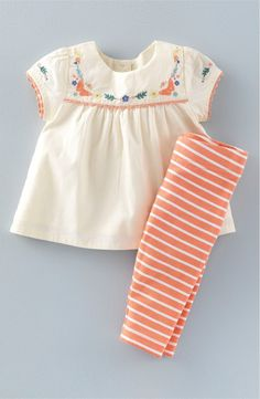 A darling top with an embroidered and pleated yoke features sweet scalloped trim, while coordinating striped leggings knit with a hint of stretch feel soft against the little one's skin.