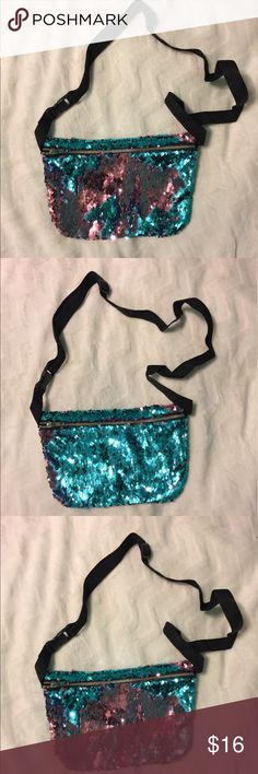 Sequins blue and pink flip change color fanny pack Sequins blue and pink flip change color fanny pack Brand new , never worn or used ! Can swipe the sequins to the left for blue and to the right for pink Super cute and perfect for the summer time !!! Nice and roomy ! Bags