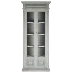A modern take on grandma's china closet, this charming curio cabinet holds dishes, glassware and collectibles behind two tall glass doors. Antique distressed elm is finished in weathered grey with hints of sage green. Whether you're into vintage, eclectic or French Country, this stately cabinet will add just the right storage to your space.