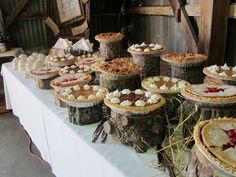 savvycityfarmer: FARM WEDDING EXTRAORDINAIRE Tree stumps cut at various heights to make food table interesting.