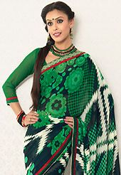 Exquisite combination of color, fabric can be seen here. This green, black and white faux georgette saree is nicely designed with floral, geometric print and graceful patch border. Saree gives you a singular and dissimilar look. Matching blouse is available. Slight color variations are possible due to differing screen and photograph resolution.