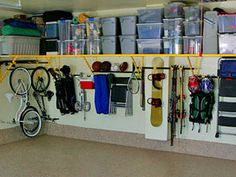 Frequently used items hang low and are easily accessible. Other items stored above in labeled clear plastic bins.