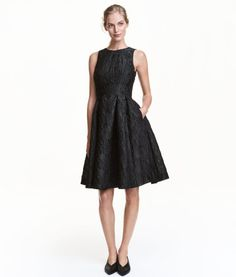 Black/patterned. Sleeveless dress in jacquard-weave fabric. Fitted bodice with cut-out section and covered elastication at back. Concealed side zip, side
