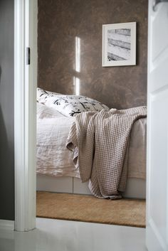 Woolen rug by the bed // RAW Design blog