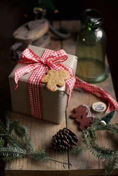 Love a gift with a gingerbread man and red and white  gingham checked bow!!!