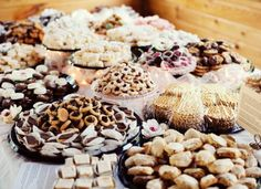 "A beautiful ""Cookie Table"" instead of cake. Eveybody loves cookies!"