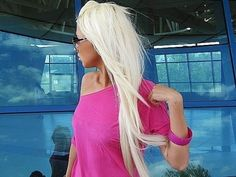 long white blonde.. if i was lean and a little taller and could get tan i would soooooo do that hair color! lol