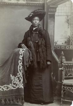 BLACK VICTORIANS: Studio portrait of Mrs. Fannie Hendricks in formal dress. Black River Falls, Wisconsin. Charles Van Schaick, photographer ca. 1893