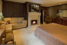 Lap of luxury: A stately master suite comes with a carved-stone mantelpiece, a plush sitti...