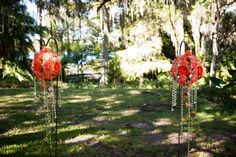 Garden Wedding Ceremony at the Harry P. Leu Gardens.  Garden Orbs dripping with crystal accents glisten in the sunlight.  Designed by Lana with Fairbanks Florist.