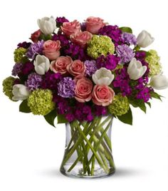 What better way to kick off Spring than with a mix of roses, tulips and more.