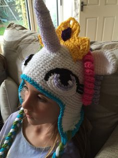 My daughter in her new Princess Celestia My Little Pony hat