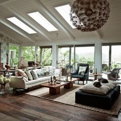 This is the beautiful home of artist and designer Amy Butler and her husband. Expansive glass walls bring the outdoors in and the views alone are enough to fall in love with this place. The mix of organic shapes and textiles, like the wicker rockers above, with mid century modern pieces, seal the deal for …