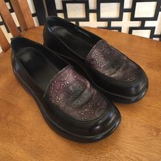 Dansko black tooled leather shoes These are in good condition but there is some wear on the tops where the shoe naturally bends. This can be touched up with shoe polish and completely covers it. Otherwise clean and have tons of wear left. Dansko Shoes Mules & Clogs