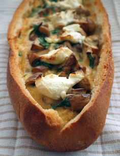 Egg boats with roasted garlic + goats cheese