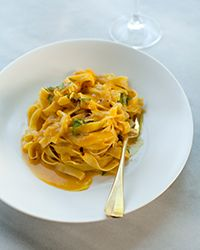 Tagliatelle pasta and sliced fennel are delicious paired with a sharp and creamy white wine and pumpkin sauce.