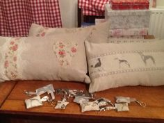Emily Bond Long Dogs on linen various key rings and vintage lace with hessian roses on linen cushions.