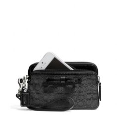 The Poppy Double Zip Wristlet In Signature C Mini Oxford Fabric from Coach. Finally something that holds my iPhone.