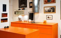 We are boldly passionate about merging and melding beauty with utility through modern design and manufacturing. Orange Kitchen, Orange Design, Solid Surface, Countertops, Modern Design, Projects, Log Projects, Counter Tops, Counter Top