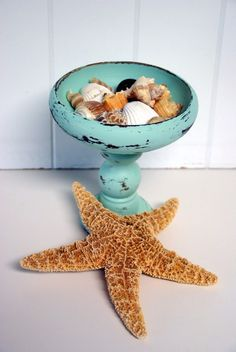 repurposed candle stick and timber bowl, or plate for cake stands, sweeeet!