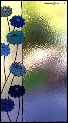 stained glass flowers within larger panel