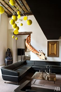 Nothing gives your room some eclectic eccentricity like a normally decorated room with a giraffe peeking through the doorway.
