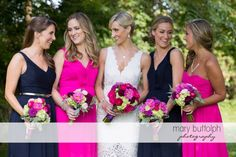 Bride and girls with dahlias, garden roses and hydrangeas