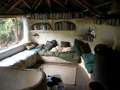 Reading is one of my family's favorite things to do. I can just see my daughter, Salena, curled up in this nook.  http://frommoontomoon.blogspot.com/2011/12/cob-houses.html