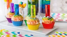 Perfect vanilla cupcakes are frosted with homemade buttercream, airbrushed with vibrant rainbow colors, and served with colorful test tube shot glasses filled with cake vodka. A great way to get any party started!
