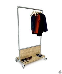 Clothing rack made with Kee Klamp. The wood accents on this are great.
